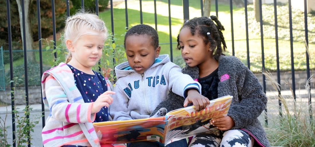 preschool children reading a book