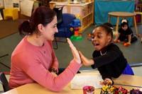 teacher and preschool student